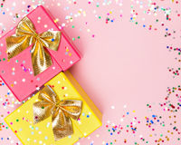 Celebratory background with color gift boxes and confetti Royalty Free Stock Photography