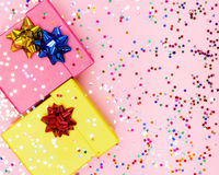 Celebratory background with color gift boxes and confetti Royalty Free Stock Images