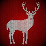 Celebratory background knitted from wool. Carpet, sweater. White deer on a red background. It warms in winter. eps 10 Stock Images