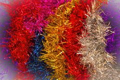 Happy New Year!. Celebratory background of shiny tinsel. Red, blue, gold and silver colors. Decoration for the Christmas tree and for the premises. Merry Stock Images