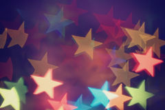 Celebratory background with a star shaped bokeh Stock Photos