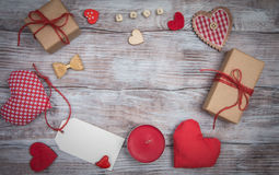 Celebratory background to Valentines day: hearts, gifts and bows Royalty Free Stock Image