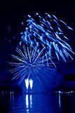 Celebratory blue firework Stock Photos