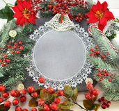 Celebratory border with napkin and Christmas decorations Stock Image