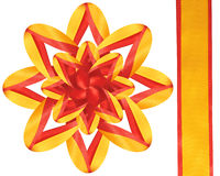 Celebratory bow from a band. Alternation of a red and yellow band do a bow bright Stock Photography