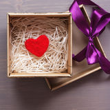 Celebratory box with a red woolen heart as a gift Stock Image
