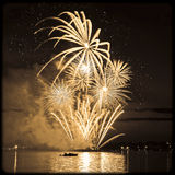 Celebratory bright firework in sky royalty free stock images