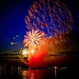 Celebratory bright firework in sky Stock Photography
