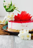 Celebratory cake and jasmine flowers Stock Image