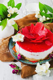 Celebratory cake and jasmine flowers Stock Photography