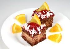 Celebratory cake and orange Royalty Free Stock Images
