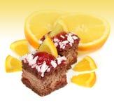 Celebratory cake and orange Royalty Free Stock Image