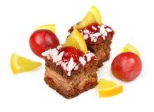 Celebratory cake and orange Stock Image