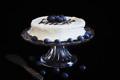 Celebratory cake with white frosting Royalty Free Stock Photography