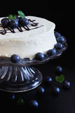 Celebratory cake with white frosting Royalty Free Stock Image