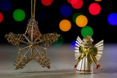 A celebratory Christmas star on a wooden table. Christmas decora Stock Photography
