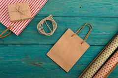 set with handmade striped shopping bag, gift bags, packing paper stock image