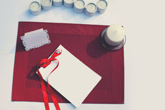 Celebratory decorated table with paper card and candles Stock Image