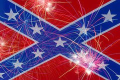 Celebratory fireworks on the background of the Confederate flag Stock Photo