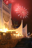 Celebratory fireworks behind theatre Royalty Free Stock Images
