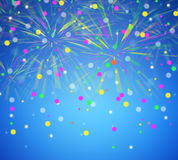 Celebratory fireworks  on a blue background. Stock Image
