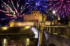 Celebratory fireworks over Castel Sant ` Angelo . River Tiber. Rome. Italy.  royalty free stock photo