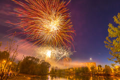 Celebratory fireworks over a pond in the city of Russia Stock Photo