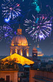 Celebratory fireworks over Rome. Italy. Stock Photos