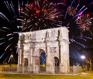 Celebratory fireworks over triumphal arch. Italy. Stock Photo
