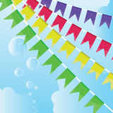 Celebratory flags. Against the cloudy sky and air bubbles Stock Image