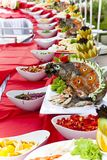 Celebratory food: stuffed fish on served table Stock Photos