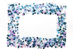 Celebratory frame. Multi-coloured five-pointed asterisks on a white background Royalty Free Stock Photo