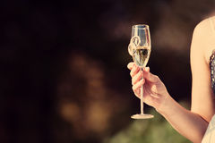 Celebratory glass of champagne in hand of bride Royalty Free Stock Image