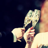 Celebratory glass of champagne in hand of bride,vintage Stock Photography