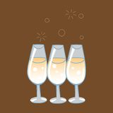 Celebratory glasses of champagne. With bursting bubbles on a neutral background Royalty Free Stock Photo