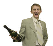 Celebratory mood. The image of the man holding a bottle of champagne Royalty Free Stock Photography