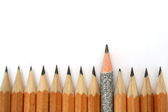 Celebratory pencil among usual pencils from bottom. 1 Royalty Free Stock Photo