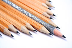 Celebratory pencil among usual pencils on a diagonal. 4 Stock Photos