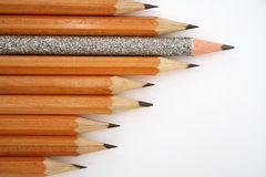 Celebratory pencil among usual pencils from left Stock Photo