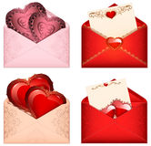 Celebratory Pink envelopes with valentines hearts  Pink open envelope with romantic purple hearts and oriental floral patterns Royalty Free Stock Photos