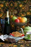 Celebratory still-life. Still-life from wine, fruit, cookies, chocolate and tea Stock Images