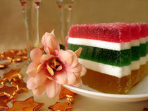 Celebratory Table (Color Jelly Cake And Flower On Plate) Royalty Free Stock Photo