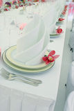Celebratory table layout. A number of beautiful plates on a celebratory table Stock Photo