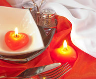 Celebratory table layout with red napkins and cand Stock Photography