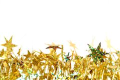 Celebratory Tinsel Of Golden Color With Christmas Stars 2 Stock Photo