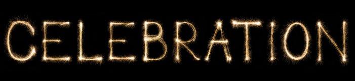 Celebrazione del testo scritto del fuoco d'artificio della scintilla su fondo nero fotografia stock