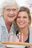 Celebrazione di famiglia delle due generazioni Fotografia Stock Libera da Diritti