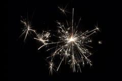 Celebri fuochi d'artificio della stella filante del partito i piccoli su fondo nero Immagine Stock Libera da Diritti
