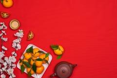 Celebri il fondo cinese del nuovo anno con frutta arancio per le guerre Immagine Stock