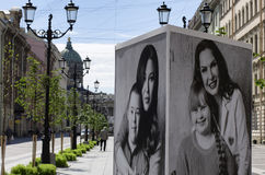 Celebrities and children with down syndrome on the posters. St. Petersburg, Russia - July 23, 2017: Posters with a charity project to help children with Down`s Royalty Free Stock Photo